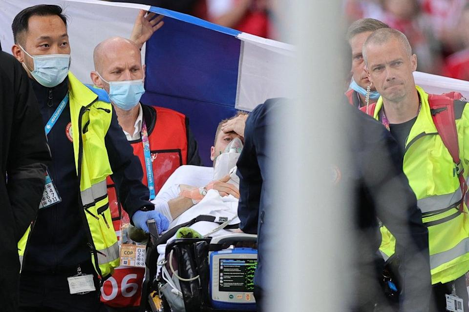 Denmark's midfielder Christian Eriksen is evacuated after collapsing on the pitch during the UEFA EURO 2020 Group B football match between Denmark and Finland (AFP via Getty)