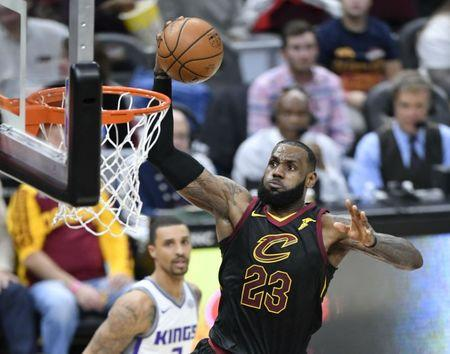 Dec 6, 2017; Cleveland, OH, USA; Cleveland Cavaliers forward LeBron James (23) drives to the basket against the Sacramento Kings in the second quarter at Quicken Loans Arena. Mandatory Credit: David Richard-USA TODAY Sports