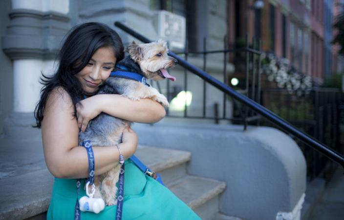 """<span class=""""caption"""">Dior Vargas stops to hug her family dog during a walk. Dior is a mental health activist who lives with depression and anxiety. Dior founded the People of Color and Mental Illness.</span> <span class=""""attribution""""><a class=""""link rapid-noclick-resp"""" href=""""https://www.gettyimages.com/detail/news-photo/dior-vargas-stops-to-hug-her-family-dog-during-a-walk-dior-news-photo/626452562?adppopup=true"""" rel=""""nofollow noopener"""" target=""""_blank"""" data-ylk=""""slk:Shaul Schwarz/Verbatim via Getty Images"""">Shaul Schwarz/Verbatim via Getty Images </a></span>"""