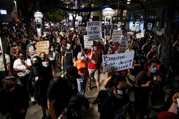 PHOTO: People march down the 16th Street Mall as they protest the grand jury decision in the Breonna Taylor case, Sept. 23, 2020, in Denver, Colorado. (Michael Ciaglo/Getty Images)