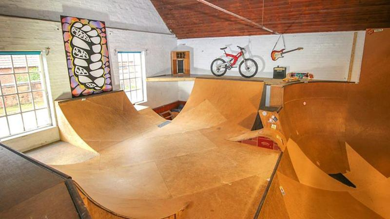 An indoor skate park inside of a home in England