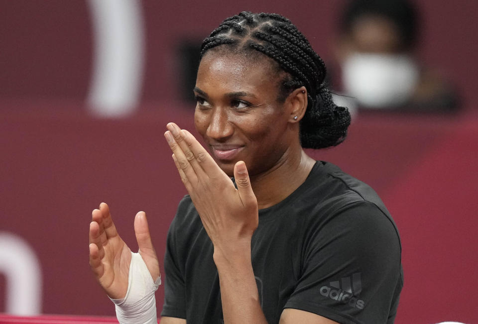 Foluke Akinradewo Gunderson, of the United States, prepares for a women's volleyball training session at the 2020 Summer Olympics, Thursday, July 22, 2021, in Tokyo, Japan. A third trip to the Olympics was far from a sure thing for Gunderson when she gave birth to her first son in November 2019. But Gunderson had set a goal of being both a mother and professional athlete and took advantage of the delayed Olympics to make it back again this year in search of that elusive gold medal. (AP Photo/Frank Augstein)