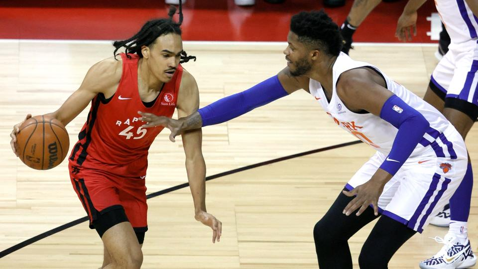 LAS VEGAS, NEVADA - AUGUST 08: Dalano Banton #45 of the Toronto Raptors is guarded by Justin Patton #50 of the New York Knicks during the 2021 NBA Summer League at the Thomas & Mack Center on August 8, 2021 in Las Vegas, Nevada. The Raptors defeated the Knicks 89-79. NOTE TO USER: User expressly acknowledges and agrees that, by downloading and or using this photograph, User is consenting to the terms and conditions of the Getty Images License Agreement. (Photo by Ethan Miller/Getty Images)