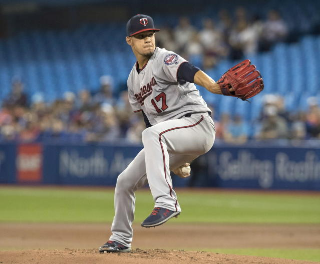 Minnesota Twins starting pitcher Jose Berrios throws against the Toronto Blue Jays in the first inning of their baseball game in Toronto on Tuesday, July 24, 2018. (Fred Thornhill/The Canadian Press via AP)