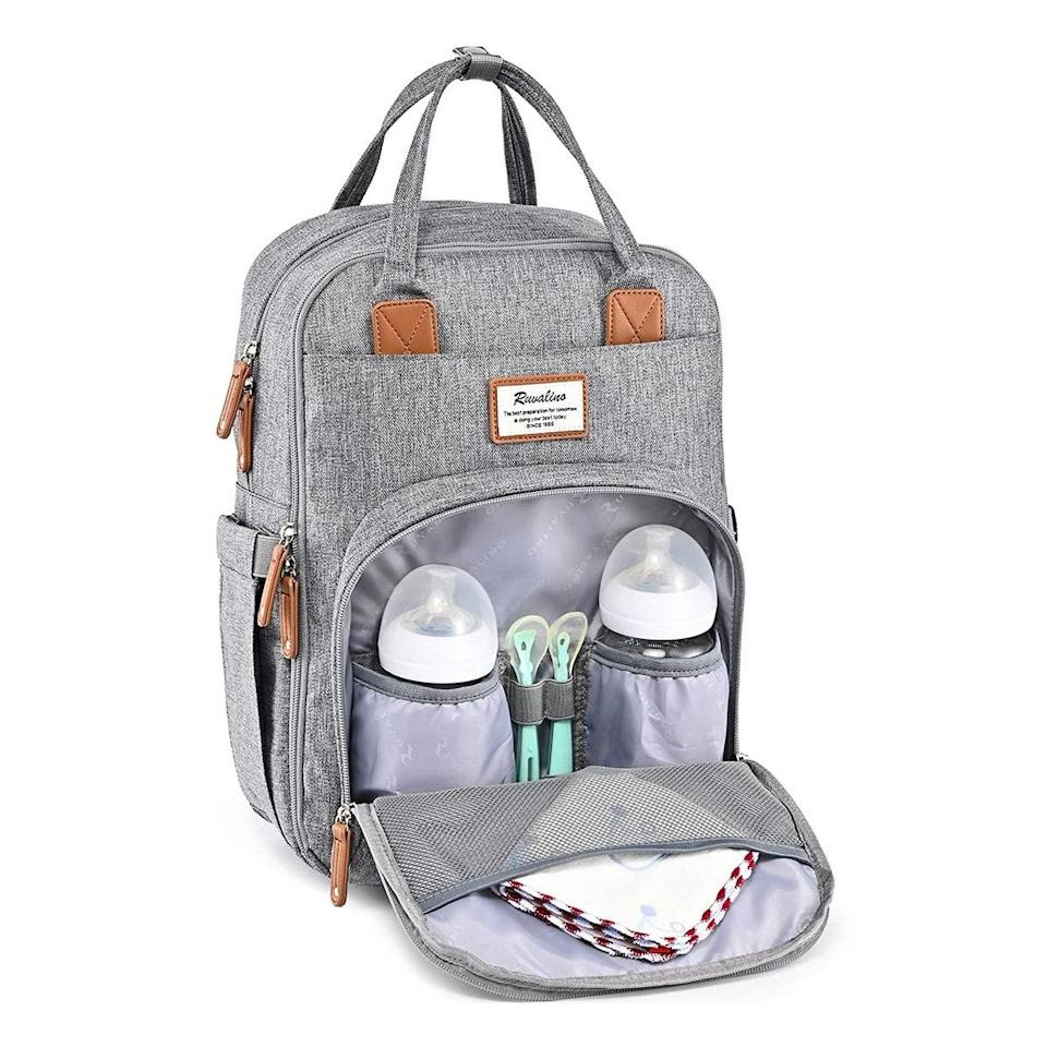 """This is a great daily diaper bag since it's a backpack style with padded shoulder straps and offered in a neutral color so that Mom and Dad can both look stylish when carrying it. The various mesh pockets make it easy to pack up everything you'd need for an outing; plus, there's room for my wallet, cell phone, and keys so that I don't need to bring a separate purse. I also like that it fits easily in the bottom part of the stroller if I don't want to carry it on my back. —<em>A.P.</em> $40, Amazon. <a href=""""https://www.amazon.com/Backpack-RUVALINO-Multifunction-Maternity-Waterproof/dp/B07C3SWZXK"""" rel=""""nofollow noopener"""" target=""""_blank"""" data-ylk=""""slk:Get it now!"""" class=""""link rapid-noclick-resp"""">Get it now!</a>"""