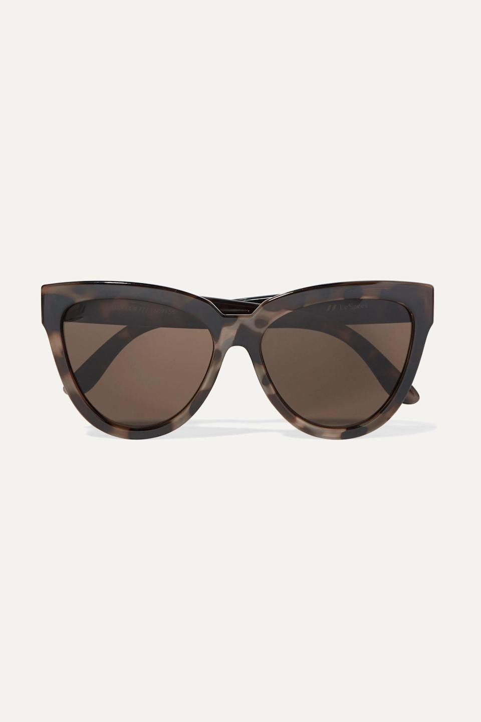 """<p><strong>Le Specs</strong></p><p>net-a-porter.com</p><p><strong>$60.00</strong></p><p><a href=""""https://go.redirectingat.com?id=74968X1596630&url=https%3A%2F%2Fwww.net-a-porter.com%2Fen-us%2Fshop%2Fproduct%2Fle-specs%2Fliar-lair-cat-eye-tortoiseshell-acetate-sunglasses%2F912467&sref=https%3A%2F%2Fwww.townandcountrymag.com%2Fstyle%2Ffashion-trends%2Fg36049858%2Fmeghan-markle-sunglasses%2F"""" rel=""""nofollow noopener"""" target=""""_blank"""" data-ylk=""""slk:SHOP NOW"""" class=""""link rapid-noclick-resp"""">SHOP NOW</a></p><p>Maybe you want to be more out-of-the-box and are looking to try sunglasses that aren't just big and black, but you still want that muted aesthetic. We suggest these ones that still have the cat-eye style, but come in a brown-and-grey finish.</p>"""