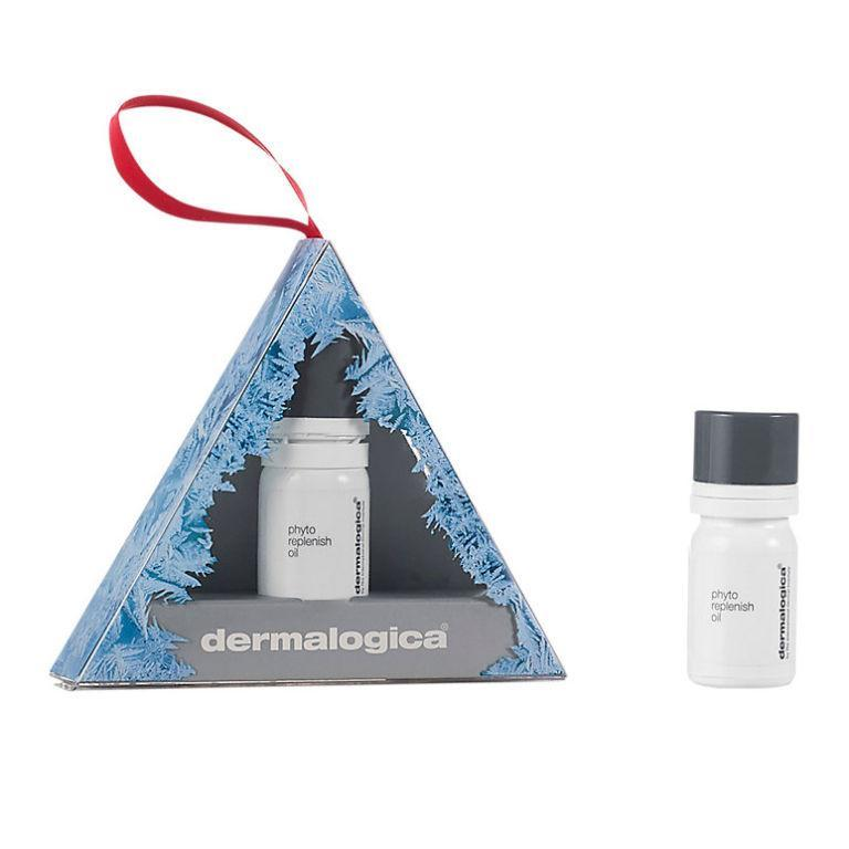 """<p><a rel=""""nofollow noopener"""" href=""""https://www.johnlewis.com/dermalogica-phyto-replenish-oil-ornament-gift/p3326392"""" target=""""_blank"""" data-ylk=""""slk:John Lewis"""" class=""""link rapid-noclick-resp"""">John Lewis</a> - £17.50</p><p>Thanks to Dermalogica's Phyto Replenish Oil, dewy, radiant skin is still attainable this Christmas - even if you do plan to drink your body weight in mulled wine and eat <em>all </em>the mince pies. We like to wear it under foundation for an Instagram-worthy glow. </p>"""