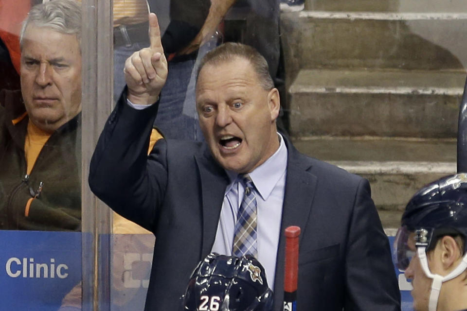 """FILE - Then-Florida Panthers coach Gerard Gallant talks to the players during a timeout in the third period of Game 1 in a first-round NHL hockey Stanley Cup playoff series against the New York Islanders in Sunrise, Fla., in this Thursday, April 14, 2016, file photo. Gallant takes on a new challenge as coach of the New York Rangers, looking to """"take a big step"""" with a young team that ownership and management thinks should be a contender. It's very different than his previous stints with expansion Vegas and Florida. (AP Photo/Alan Diaz, File)"""