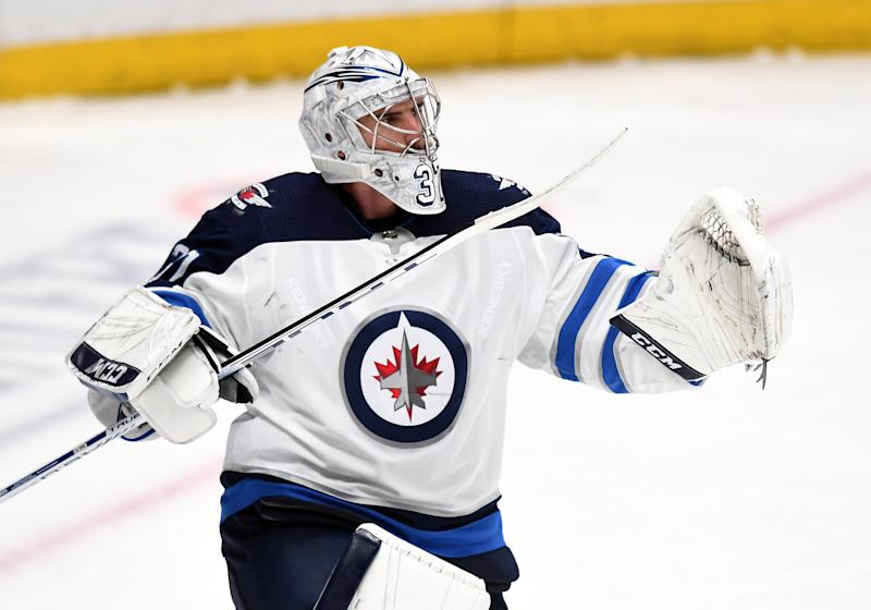 Winnipeg Jets goalie Connor Hellebuyck (37) pumps his stick after the Jets defeated the Anaheim Ducks