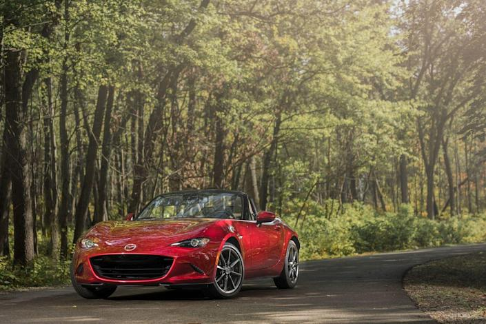 "<p><a href=""https://www.caranddriver.com/mazda/mx-5-miata"" rel=""nofollow noopener"" target=""_blank"" data-ylk=""slk:Driving a Mazda Miata"" class=""link rapid-noclick-resp"">Driving a Mazda Miata</a> is the unstructured play of the automotive world: often a solitary activity, beneficial to one's development, and a whole lot of fun. Just as playing with dolls allows kids to practice social interaction in a way that helps them navigate real-life relationships, learning to break the tail loose or heel-and-toe your downshifts in a Miata helps ingrain the skills you'll need if you want to execute those tricks in something a little less forgiving. The Miata is the sports-car version of training wheel</p>"