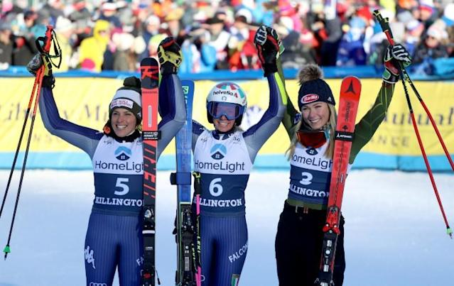 Federica Brignone of Italy in second place, Marta Bassino in first place and Mikaela Shriffrin of the United States in third place celebrate on the podium after the women's alpine World Cup giant slalom in Killington, Vermont (AFP Photo/TOM PENNINGTON)