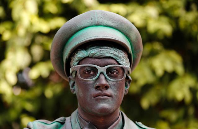 "<p>An artist called ""Le Facteur/The Postman"" takes part in the festival ""Statues en Marche"" in Marche-en-Famenne, Belgium, July 22, 2018. (Photo: Yves Herman/Reuters) </p>"