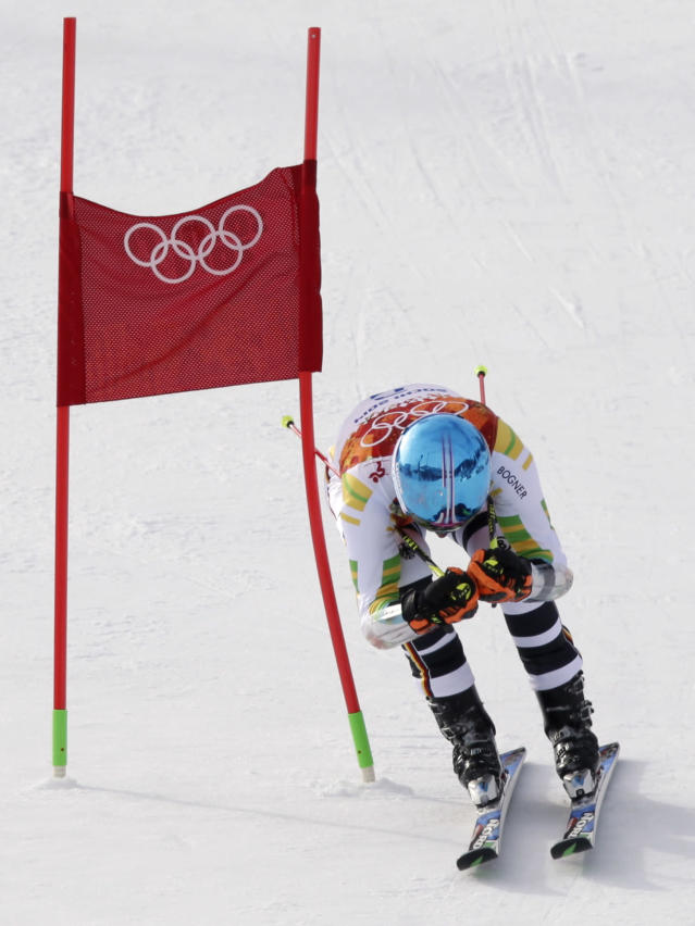 Germany's Felix Neureuther passes a gate in the first run of the men's giant slalom at the Sochi 2014 Winter Olympics, Wednesday, Feb. 19, 2014, in Krasnaya Polyana, Russia. (AP Photo/Gero Breloer)