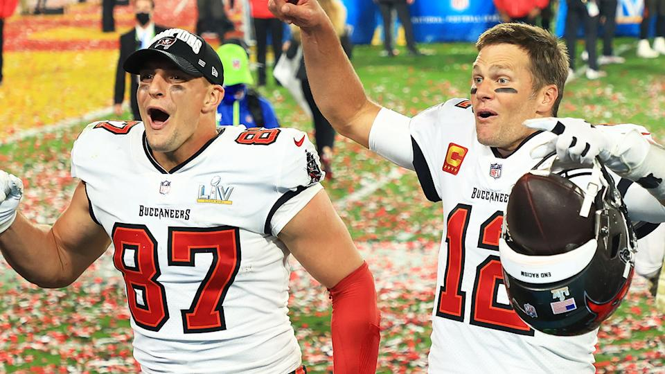Rob Gronkowski (pictured left) celebrating the Super Bowl win with Tom Brady (pictured right).