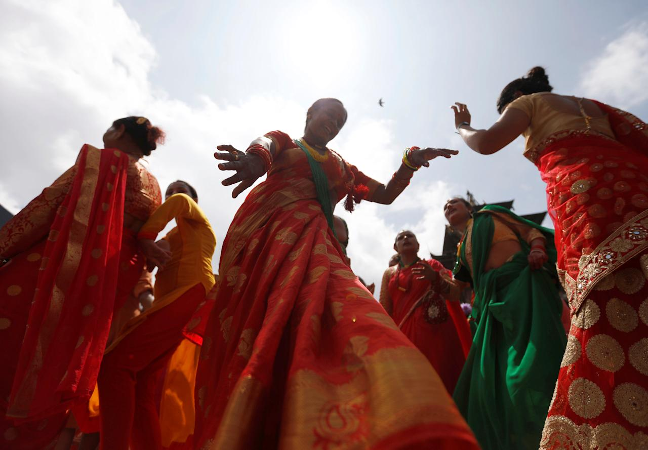 <p>Women sing and dance during the Teej festival in Kathmandu, Nepal September 12, 2018. REUTERS/Navesh Chitrakar </p>
