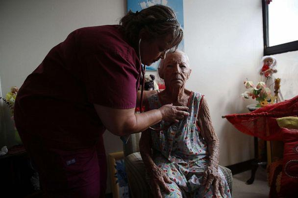 PHOTO: A doctor from the First Medical Relief team gives a patient at an assisted living facility a checkup, Oct. 1, 2017, in San Juan, Puerto Rico. (Joe Raedle/Getty Images, FILE)
