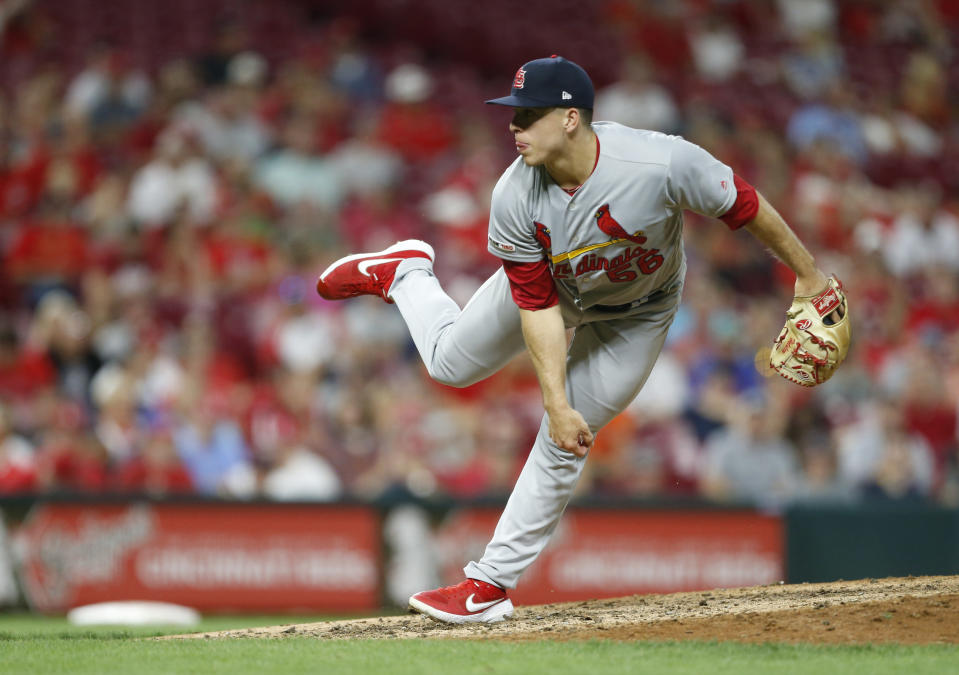 FILE - In this Aug. 15, 2019, file photo, St. Louis Cardinals relief pitcher Ryan Helsley throws against the Cincinnati Reds during the eighth inning of a baseball game in Cincinnati. Helsley was disappointed by his first exposure to the Atlanta Braves fans use of the Tomahawk Chop for their chants during games. Helsleys vantage point is different than most players who visit SunTrust Park. He is a member of the Cherokee nation. (AP Photo/Gary Landers, File)