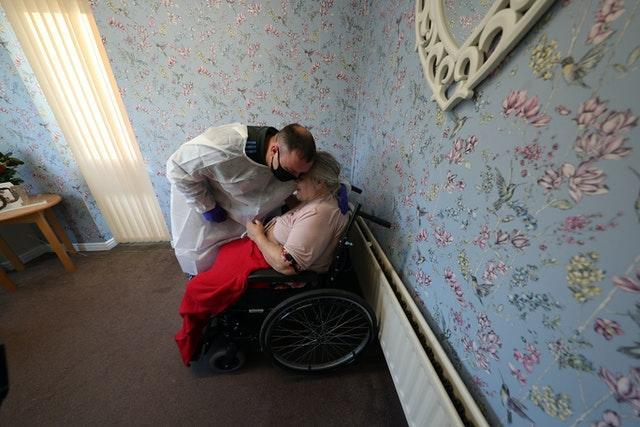 Man embraces mother at care home on Christmas Day