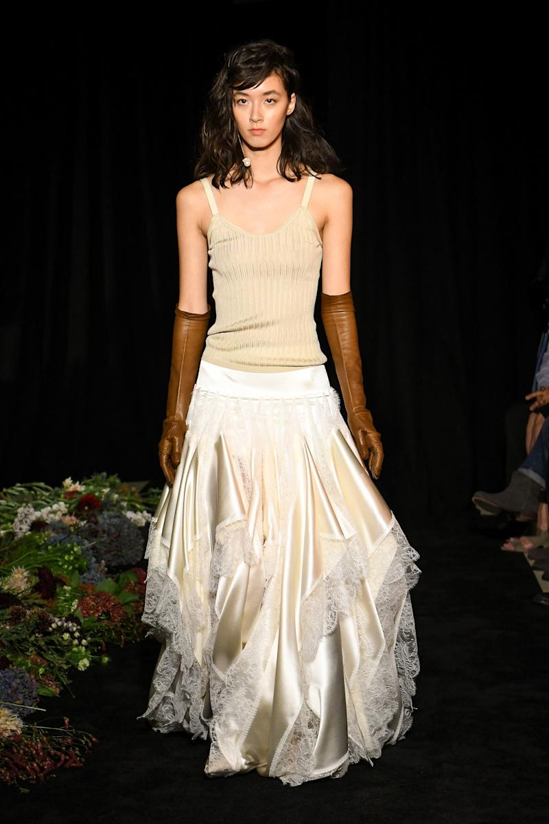 Separates remain a big trend in bridal. Danielle Frankel styled this handkerchief satin skirt with a knit tank.