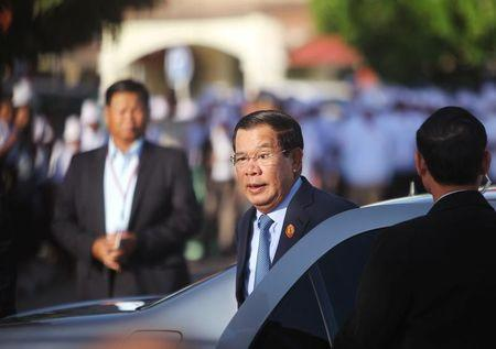 Hun Sen who is also president of the ruling Cambodian People's Party, arrives before a ceremony to mark the 66th anniversary of the establishment of the party at Koh Pich island in Phnom Penh