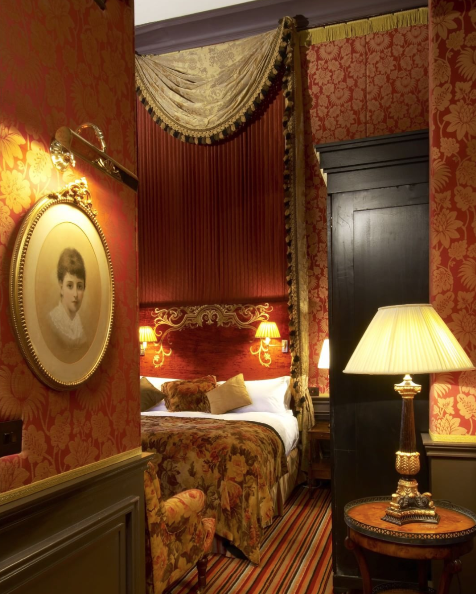 """<p><span>Belfast prices are far more reasonable than in London, but a night in one of The Merchant's five <a href=""""https://www.themerchanthotel.com/rooms-suites/sumptuous-suites/"""" rel=""""nofollow noopener"""" target=""""_blank"""" data-ylk=""""slk:Victorian Suites"""" class=""""link rapid-noclick-resp"""">Victorian Suites</a> will still set you back at least</span><b> £350 </b><span>per night. At least you'll be surrounded by opulent decor, antique fireplaces and marble bathrooms. You'll also be able to have a dip in the rooftop hot tub. [Photo: Instagram / </span><a href=""""https://www.instagram.com/merchantbelfast/"""" rel=""""nofollow noopener"""" target=""""_blank"""" data-ylk=""""slk:merchantbelfast"""" class=""""link rapid-noclick-resp""""><span>merchantbelfast</span></a><span>]</span> </p>"""