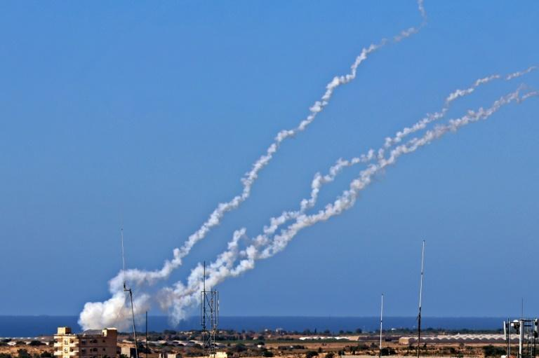 A picture taken on May 19, 2021 shows rockets being fired by Palestinian militants towards Israel, near Rafah in the southern Gaza Strip