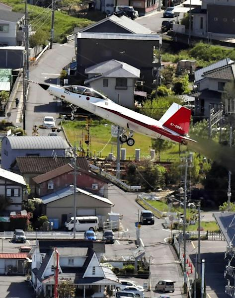 Japan's first stealth fighter jet the X-2 successfully takes to the skies as the country joins a select group of world military powers wielding the radar-dodging technology
