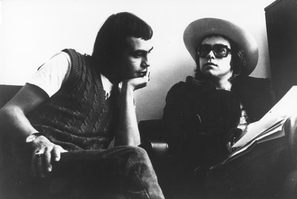 LONDON - CIRCA 1973: Pop singer Elton John and his lyricist Bernie Taupin (left) pose for a portrait in circa 1973 in London, England. (Photo by Michael Ochs Archives/Getty Images)