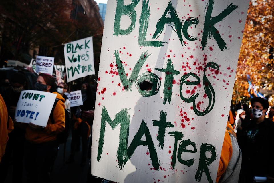 """Protesters held signs that read """"Black Votes Matter"""" outside of the Philadelphia Convention Center as the counting of ballots continued in the state on Nov. 6"""