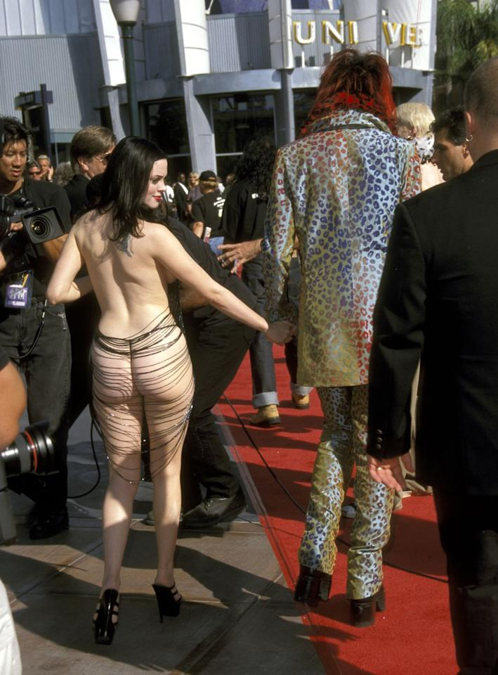 <p>Easily in the top three most shocking VMA's outfits ever, Rose McGowan rocked up to the 1998 red carpet with Marilyn Manson and not much in the way of clothes.</p>