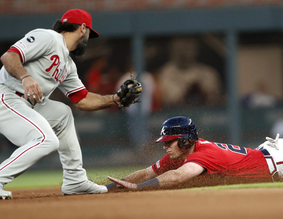 Atlanta Braves' Austin Riley slides, but is tagged out by Philadelphia Phillies second baseman Sean Rodriguez as he tried to steal second base during the fourth inning of a baseball game Friday, June 14, 2019, in Atlanta. (AP Photo/John Bazemore)