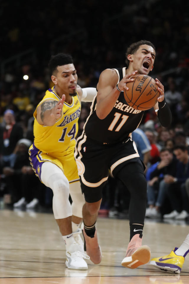 Atlanta Hawks guard Trae Young (11) drives past Los Angeles Lakers guard Danny Green (14) in the first half of an NBA basketball game Sunday, Dec. 15, 2019, in Atlanta. (AP Photo/John Bazemore)