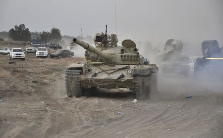 A tank is pictured as Iraqi security forces patrol after clashes with militants of the Islamic State, formerly known as the Islamic State in Iraq and the Levant (ISIL), in the Hamrin mountains in Diyala province July 16, 2014. REUTERS/Stringer