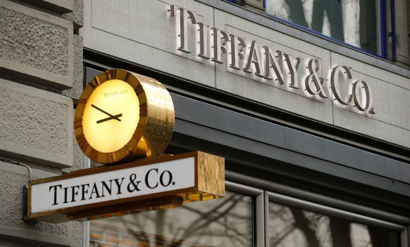 A clock is placed in front of a store of U.S. jeweller Tiffany in Zurich