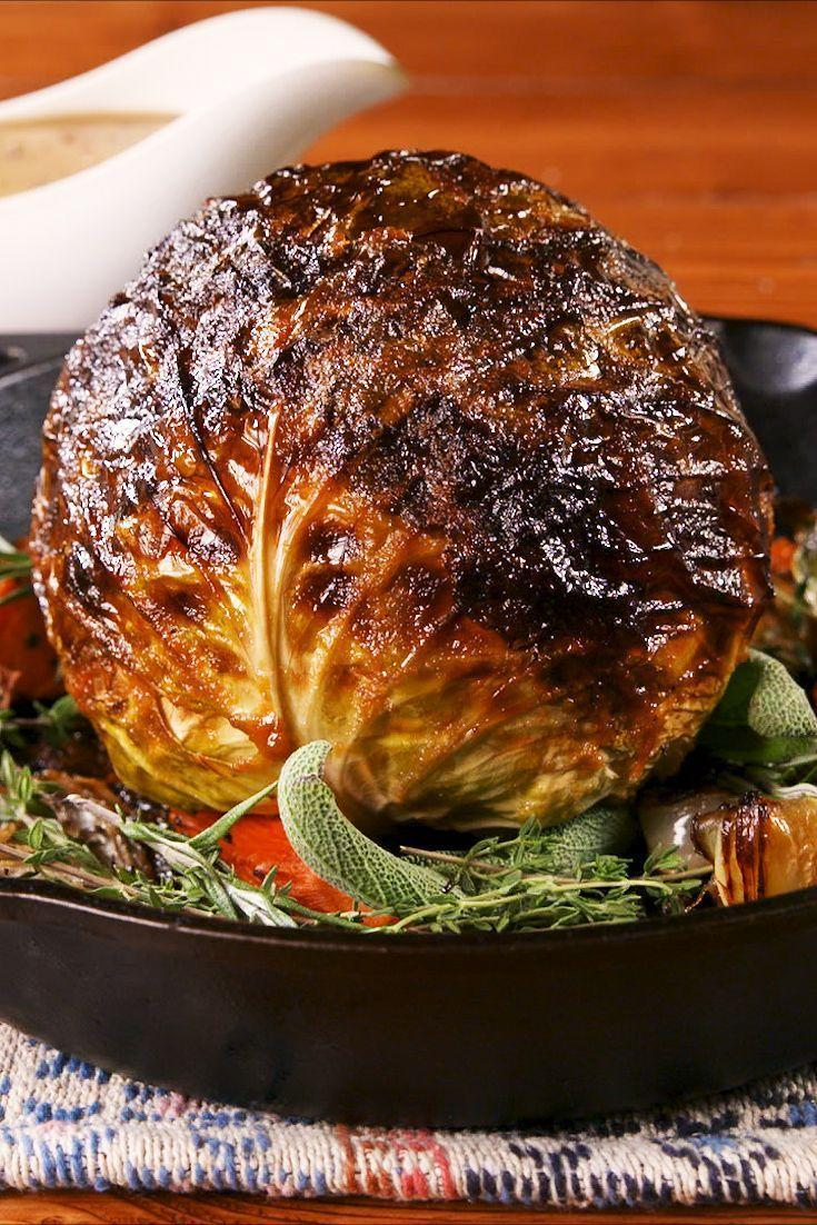 """<p>This gorgeous, whole-roasted cabbage is the perfect holiday substitute for vegetarians.</p><p>Get the recipe from <a href=""""https://www.delish.com/holiday-recipes/thanksgiving/a24850980/thanksgiving-cabbage-recipe/"""" rel=""""nofollow noopener"""" target=""""_blank"""" data-ylk=""""slk:Delish"""" class=""""link rapid-noclick-resp"""">Delish</a>. </p>"""