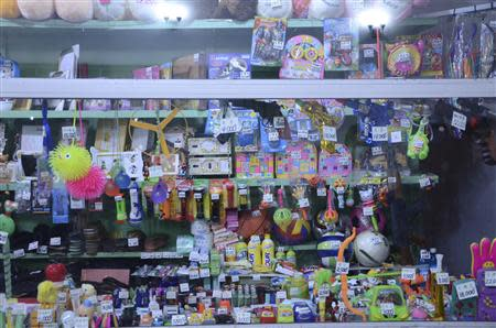 Handout picture of toys and other small items tagged with their prices based on grey market rates in a shop in downtown Pyongyang