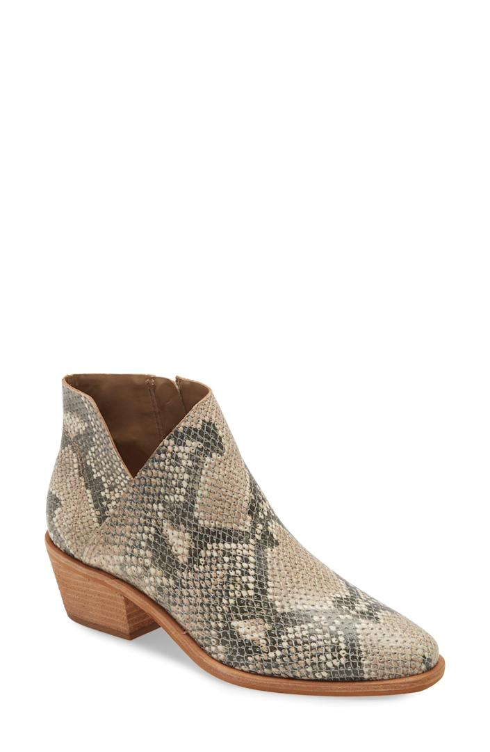 """<p><strong>VINCE CAMUTO</strong></p><p>nordstrom.com</p><p><strong>$59.97</strong></p><p><a href=""""https://go.redirectingat.com?id=74968X1596630&url=https%3A%2F%2Fwww.nordstrom.com%2Fs%2Fvince-camuto-arendara-bootie-women%2F5599770&sref=https%3A%2F%2Fwww.goodhousekeeping.com%2Fclothing%2Fg36292464%2Fbest-summer-boots%2F"""" rel=""""nofollow noopener"""" target=""""_blank"""" data-ylk=""""slk:Shop Now"""" class=""""link rapid-noclick-resp"""">Shop Now</a></p><p>These snakeskin booties have had a summer makeover with the wooden block heel and platform. Versatile yet bold, reviewers love that these booties complete their wardrobe with one reviewer saying they're <strong>""""comfortable right out of the box and the heel is not too high but not too low either.""""</strong> If between sizes, the brand recommends going up half a size for a better fit. </p>"""