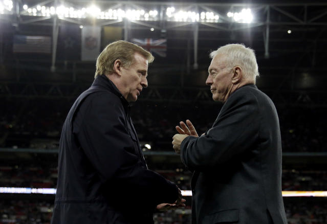 Not so fast: According to an ESPN report, Dallas owner Jerry Jones (R) is impeding contract talks with NFL commissioner Roger Goodell. (AP)