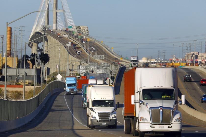 Trucks move across Terminal Island through the ports of Los Angeles and Long Beach in July, 2021.