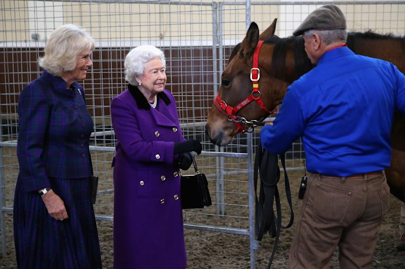 Duchess of Cornwall and Queen Elizabeth II attend a horse whispering demonstration by Brooke Global Ambassador Monty Roberts at the Royal Mews, Buckingham Palace, London.