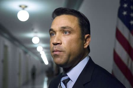 File of U.S. Representative Grimm talking to reporters outside his office on Capitol Hill in Washington