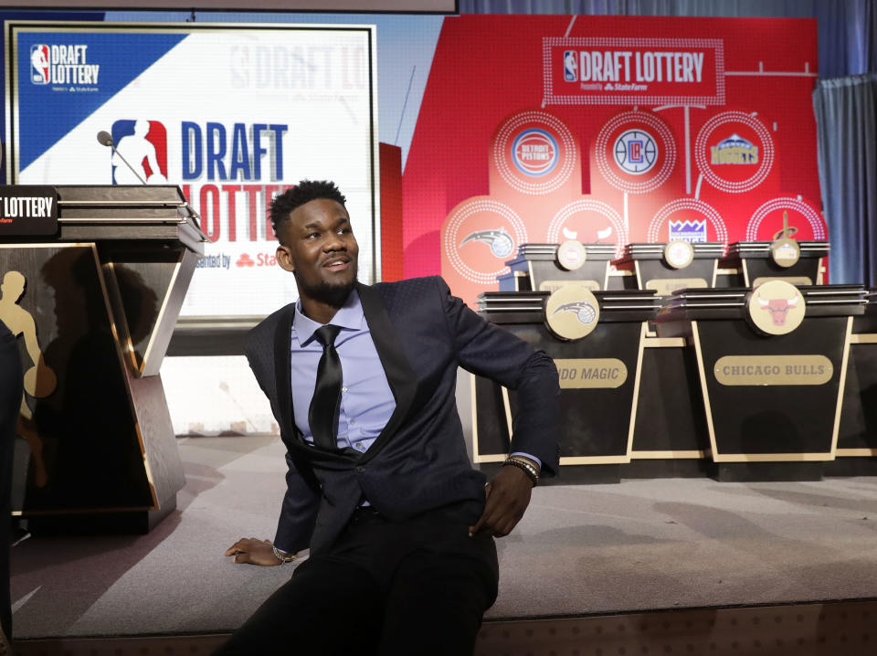 Deandre Ayton relaxes before the NBA draft lottery Tuesday night. (AP)