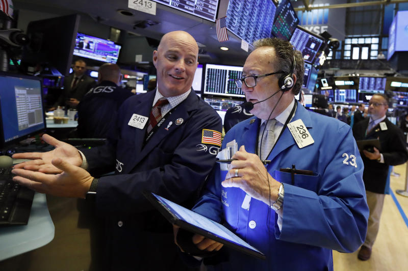Specialist John O'Hara, left, and trader Steven Kaplan work on the floor of the New York Stock Exchange, Wednesday, Sept. 4, 2019. Stocks are opening higher on Wall Street following big gains in Asia as Hong Kong's government withdrew a controversial extradition law that set off three months of protests there. (AP Photo/Richard Drew)