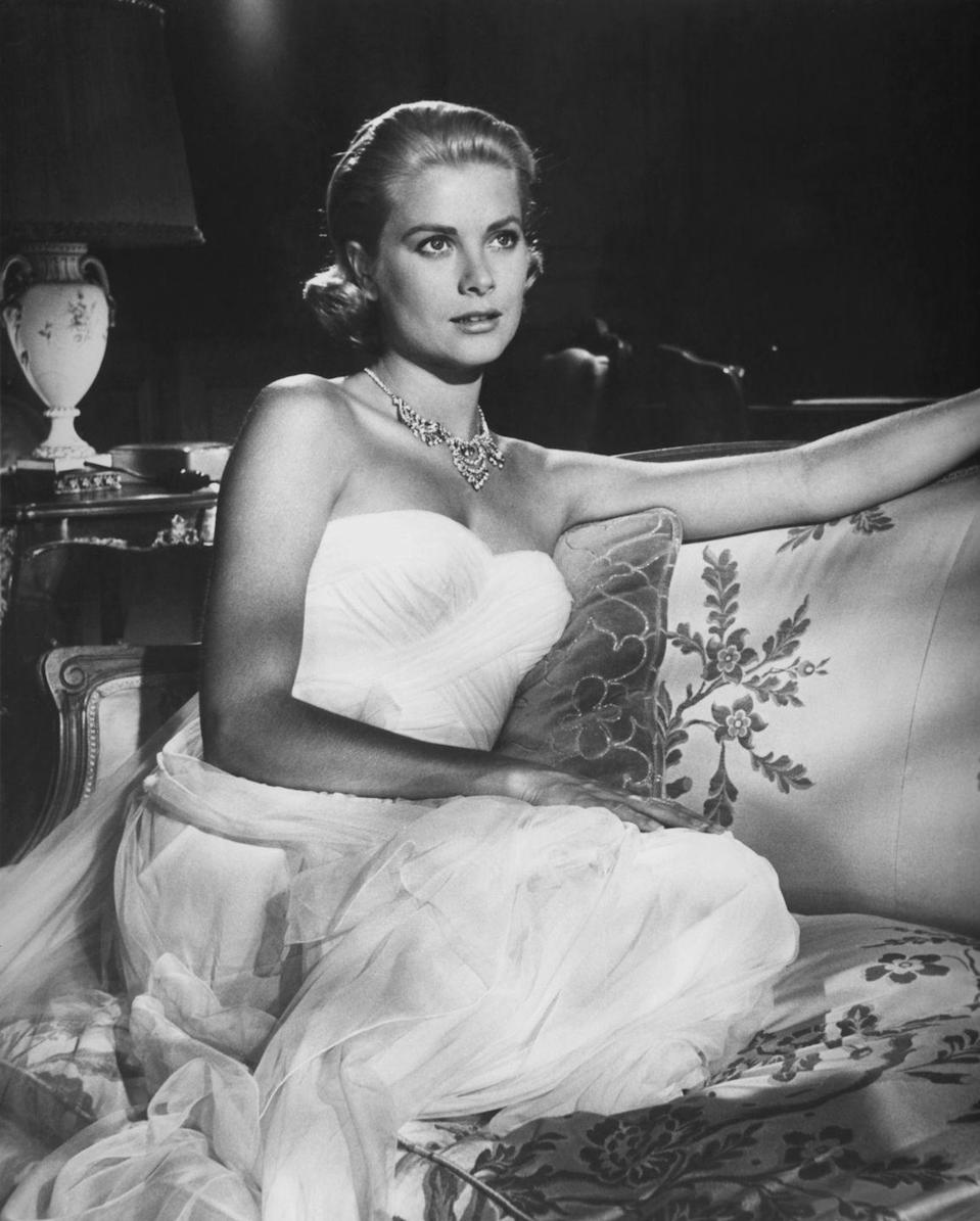 <p>While portraying a wealthy heiress on vacation in the South of France, Grace Kelly managed to look the part in a white strapless chiffon evening gown and diamond necklace that we're sure no jewel thief could resist.</p>
