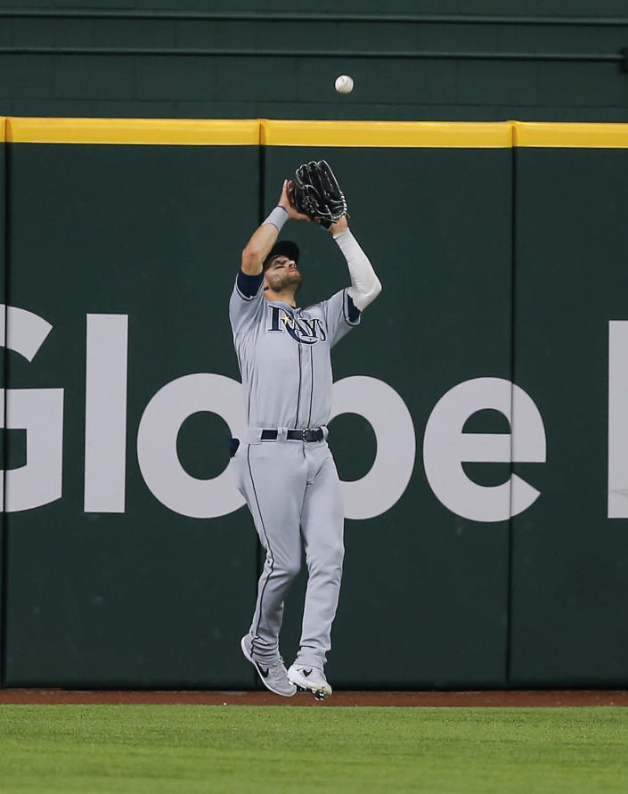 Tampa Bay Rays center fielder Kevin Kiermaier catches a flyout hit by Texas Rangers' Nate Lowe during the fifth inning of a baseball game, Saturday, June 5, 2021, in Arlington, Texas. (AP Photo/Brandon Wade)