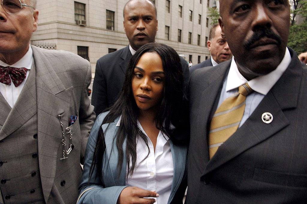 """Lil Kim is surrounded by security as she leaves the Manhattan Federal Court after her Sentencing hearing. Jemal Countess/<a href=""""http://www.wireimage.com"""" target=""""new"""">WireImage.com</a> - July 6, 2005"""
