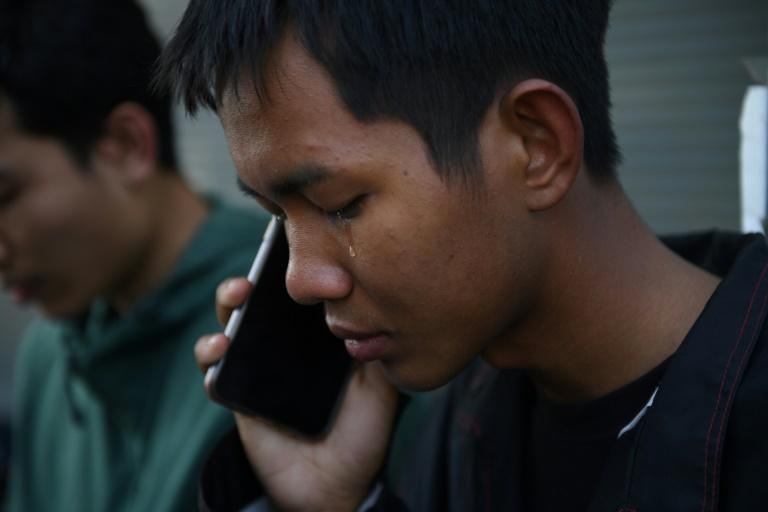 A tear falls from the eye of Weerapat Ketsunthia as he talks on the phone and mourns his friend Atiwat Promsuk, who was killed in a mass shooting at the Terminal 21 shopping mall in Nakhon Ratchasima, Thailand (AFP Photo/CHALINEE THIRASUPA)