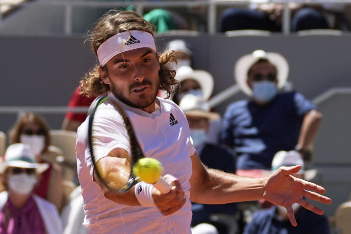 Stefanos Tsitsipas of Greece slams a forehand to Serbia's Novak Djokovic during their final match of the French Open tennis tournament at the Roland Garros stadium Sunday, June 13, 2021 in Paris. (AP Photo/Michel Euler)