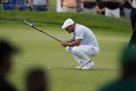 Bryson DeChambeau eyes his putt on the third green during the second round of the Rocket Mortgage Classic golf tournament, Friday, July 2, 2021, at the Detroit Golf Club in Detroit. (AP Photo/Carlos Osorio)