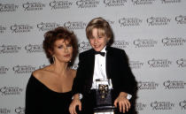 Unspecified - 1991: (L-R) Raquel Welch, Macaulay Culkin at the 5th Annual American Comedy Awards, April 3, 1991. (Photo by Daniel Watson/Walt Disney Television via Getty Images)